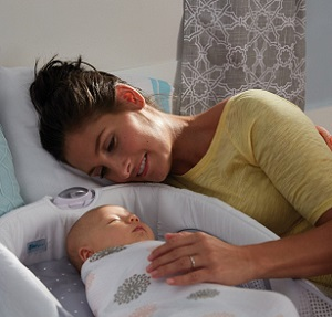 Image: The First Years Close and Secure Sleeper - Removable nightlight makes it easy for you to check on baby during the night